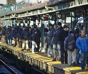 In this Tuesday, Feb. 5, 2013 photo, rush hour commuters crowd a subway platform at the Woodside station in Queens, N.Y.