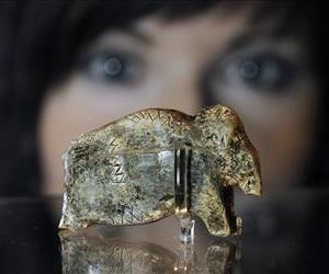 A woman views what is claimed to be the oldest known art work of mankind, at the Neanderthal Museum in Mettmann, western Germany, Friday, Nov. 19, 2010.