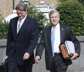 Former Virginia Gov. Bob McDonnell, right, arrives at federal court with his attorney, John Brownlee, Wednesday.
