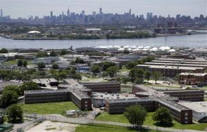 FILE- This June 20, 2014 file photo shows the Rikers Island jail with the New York skyline in the background.