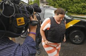 Deputies escort Nicole Vaisey, 25, into Fowler Town Court in Fowler, NY for her preliminary hearing yesterday.