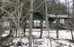 In this Jan. 31, 2010 file photo, the former home of author J.D. Salinger sits among trees in Cornish, N.H. The home, which Salinger bought in the 1950's, is up for sale.