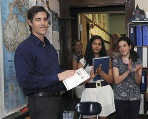 In this June 17, 2011 photo, journalist James Foley receives applause from students at the Christa McAuliffe Regional Charter Public School in Framingham, Mass.