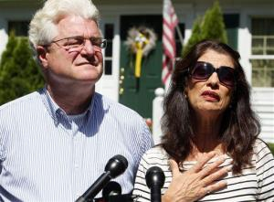 Diane and John Foley talk to reporters on Wednesday in Rochester, NH.