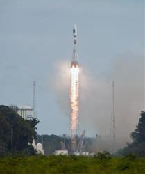 The medium-lift VS07 Soyuz rocket lifts off from Kourou, French Guiana, Friday Aug. 22, 2014. The European Space Agency launched two satellites for its new global navigation system.