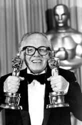 In this Monday, April 11, 1983 file photo, British actor and director Richard Attenborough holds his two Oscars for his epic movie Gandhi at the 55th annual Academy Awards in Los Angeles, Calif.