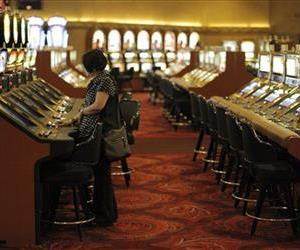 A tourist plays a slot machine at the MGM Grand in Las Vegas, Tuesday, Nov. 18, 2008.