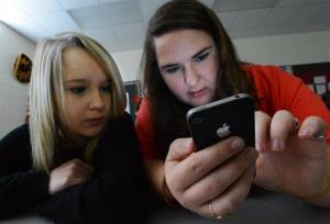 Students at Hartselle High School in Hartselle, Ala., use personal technology devices like cell phones and tablets for social media and academics.