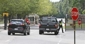 Security guards open a gate for motorist at the visitor entrance to Fort Lee yesterday.
