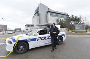 A police officer stands outside an Ontario courthouse in this file photo.