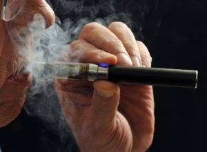 In this Jan. 17, 2014, file photo, a smoker demonstrates an e-cigarette in Wichita Falls, Texas.