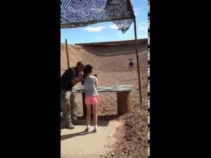 The girl is seen receiving instruction at the Arizona range in this image from video released by police.