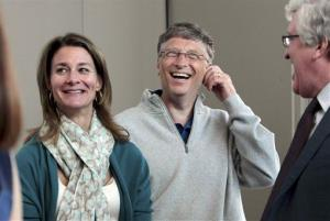 Melinda Gates, left, and husband Bill Gates laugh at a reception Thursday, June 2, 2011, in Seattle.