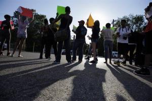 This Aug. 12 photo shows protesters standing on a street in Ferguson, Mo.