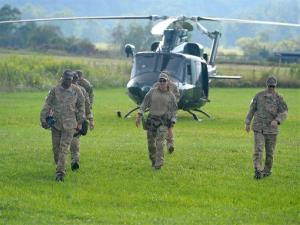 A team walks away from the helicopter they arrived in at the mobile command center in Deerfield, Va., yesterday.
