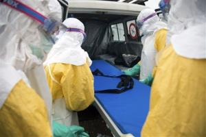 Participants load a stretcher into an ambulance during a training course to instruct NGO workers and doctors on how to deal with the Ebola virus in Brussels on Tuesday, Aug. 26, 2014.