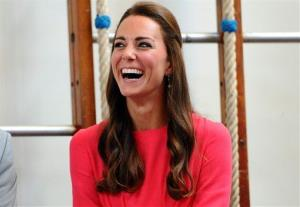 Britain's Kate Middleton reacts during her visit to the Blessed Sacrament School, in London, Tuesday, July 1, 2014.