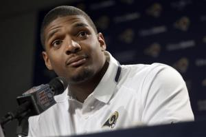 In this May 13, 2014, file photo, St. Louis Rams seventh-round draft pick Michael Sam listens to a question during a news conference at the NFL football team's practice facility in St. Louis.