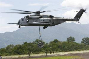 A US military helicopter, the CH-53E Super Stallion airlifts humanitarian aid to be dropped in affected regions around Pariaman, north of Padang, Indonesia on Saturday Oct. 10, 2009.