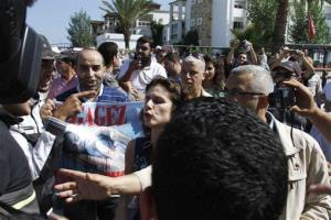 Anti-abortion protesters mob Rebecca Gomperts, center, the Dutch founder of Women on Waves, an abortion advocacy group, on Oct. 4, 2012, in the port of Smir, Morocco.