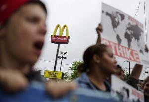 Demonstrators protest outside a McDonald's restaurant demanding better wages, Thursday, May 15, 2014, in Atlanta.