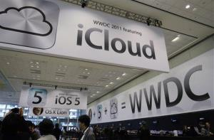 In this 2011 file photo, posters are displayed at the Apple Worldwide Developers Conference in San Francisco.
