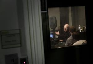 "In this Aug. 29, 2014, picture, musician Thomas Dolby is seen through a recording studio window as he speaks with students in his class, Sound on Film,"" at Johns Hopkins University in Baltimore."