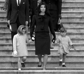 In this Nov. 24, 1963 photo, Jacqueline Kennedy walks down the Capitol steps with daughter Caroline and son John Jr. after President John. F. Kennedy's casket was placed in the rotunda in Washington.