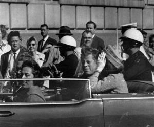 This Nov. 22, 1963 file photo shows President John F. Kennedy riding in motorcade with first lady Jacqueline Kenndy before he was shot in Dallas, Texas.