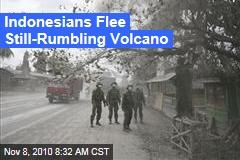Indonesians Flee Still-Rumbling Volcano