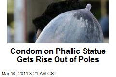Condom on Phallic Statue Gets Rise Out of Poles