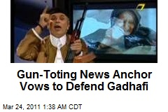 Gun-Toting News Anchor Vows to Defend Gadhafi
