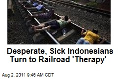 Indonesians Get Unconventional Medical Treatment From Lying on Train Tracks