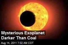 Mysterious Exoplanet Darker Than Coal