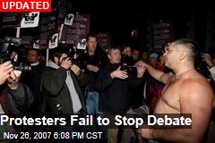 Protesters Fail to Stop Debate