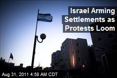 Israel Arming Settlements as Protests Loom