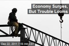Economy Surges, But Trouble Looms