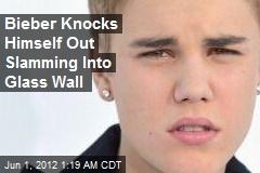 Bieber Knocks Himself Out Crashing Into Glass Wall
