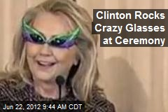 Clinton Rocks Crazy Shades at Ceremony