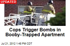 Cops Trying to Enter Booby-Trapped Apartment