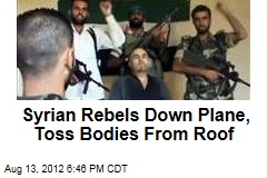 Syrian Rebels Down Plane, Toss Bodies From Roof