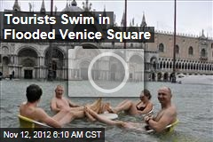 Tourists Swim in Flooded Venice Square