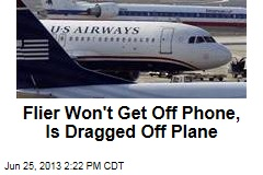 Flier Won't Get Off Phone, Is Dragged Off Plane