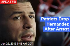 Patriots' Hernandez Hauled From Home in Cuffs