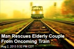 Man Rescues Elderly Couple From Oncoming Train