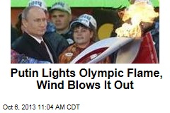Putin Lights Olympic Flame, Wind Blows It Out