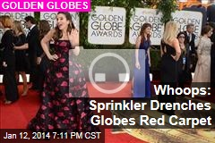 Whoops: Sprinkler Drenches Globes Red Carpet