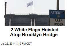2 White Flags Hoisted Atop Brooklyn Bridge