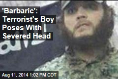 'Barbaric': Terrorist's Boy Poses With Severed Head