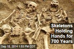 Skeletons Holding Hands for 700 Years
